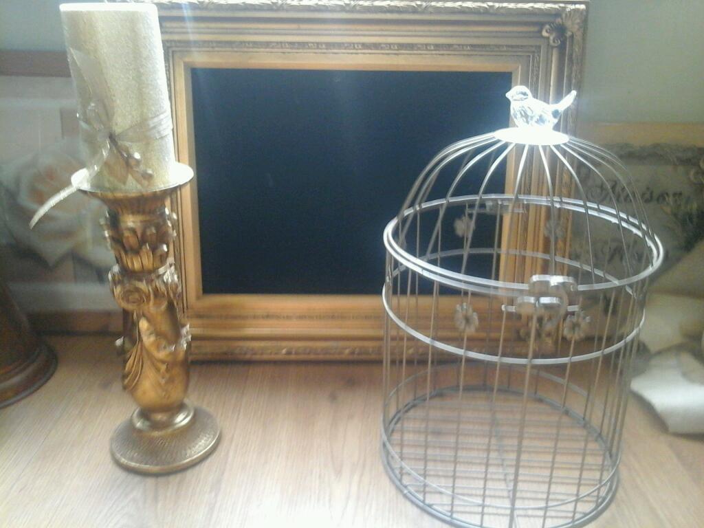 Gold framed blackboard, candleholder and birdcage.