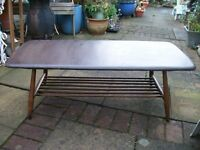 Rectangular Ercol Windsor Coffee Table with magazine / books rack and original Ercol blue label.