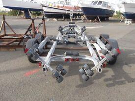 Galvanised, Twin Axel, swinging roller heavy duty boat trailer.