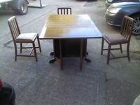 LARGE DARK OAK SOLID ANTIQUE DROP LEAF TABLE WITH END STORAGE AND 3 WOODEN FABRIC CHAIRS