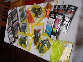 ASSORTED BOX OF SHADS,SEA RIGS & JELLIES.