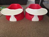 Two Red Bumbo Baby Seats