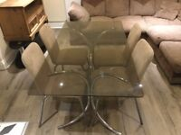 Tinted glass dining table +4 chairs
