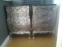 Two black & silver embossed bedside units with four drawers.