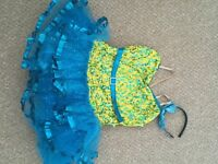 Yellow and turquoise sequinned dancing costume