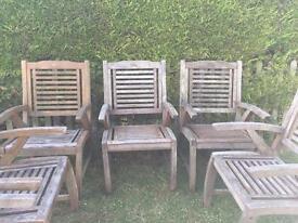 Six heavy solid teak garden chairs