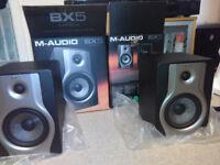 Pair of M-Audio BX5 Carbon studio monitors