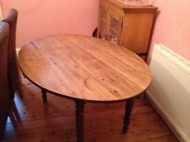 DROP LEAF TABLE AND 6 CHAIRS.