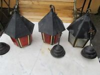 Three vintage porch hanging lanterns. Two with orange pattern glass and one clear patterned glass.