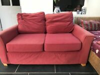 Two seater red sofa free . Collection only.