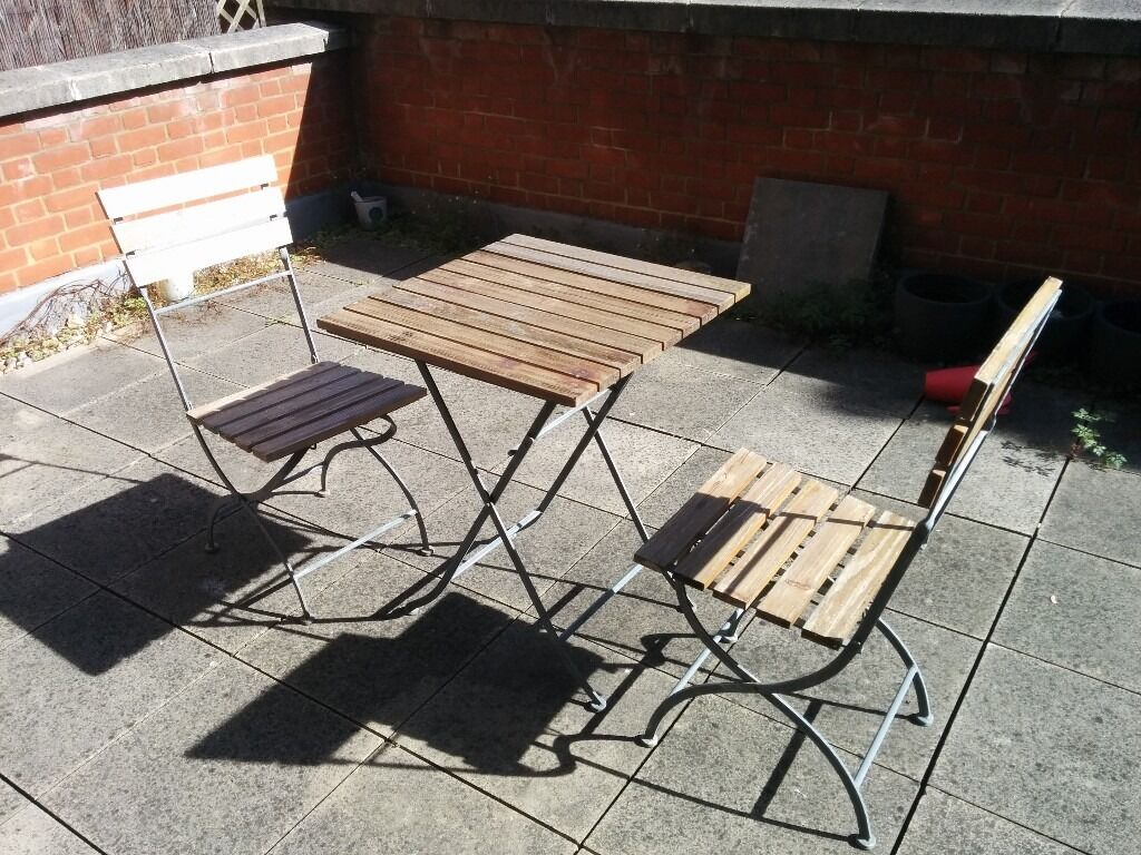 Wood and metal table and 2 chairs, foldable, perfect for balcony or terracein Fulham, LondonGumtree - A table and two chairs. Matte wood finish, metal structure. Foldable and lightweight for easy storage. Perfect for a small balcony or a terrace. Selling them cheap because Im moving to a flat with no balcony or terrace (