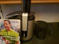 Philips HR1861 Juicer with book.