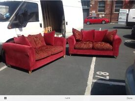 Pair of 2 seater red and gold DFS SOFAS
