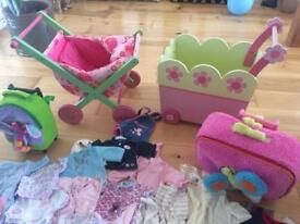 Baby annabel clothes, 2 wooden toy prams and children's rucksacks