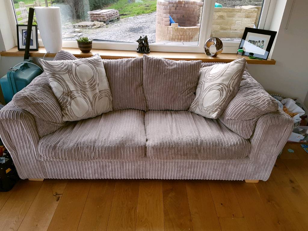 Two x 3 seater sofa and storage footstool for sale