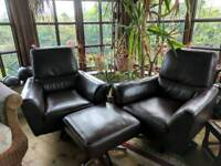 2 brown leather chairs and stall