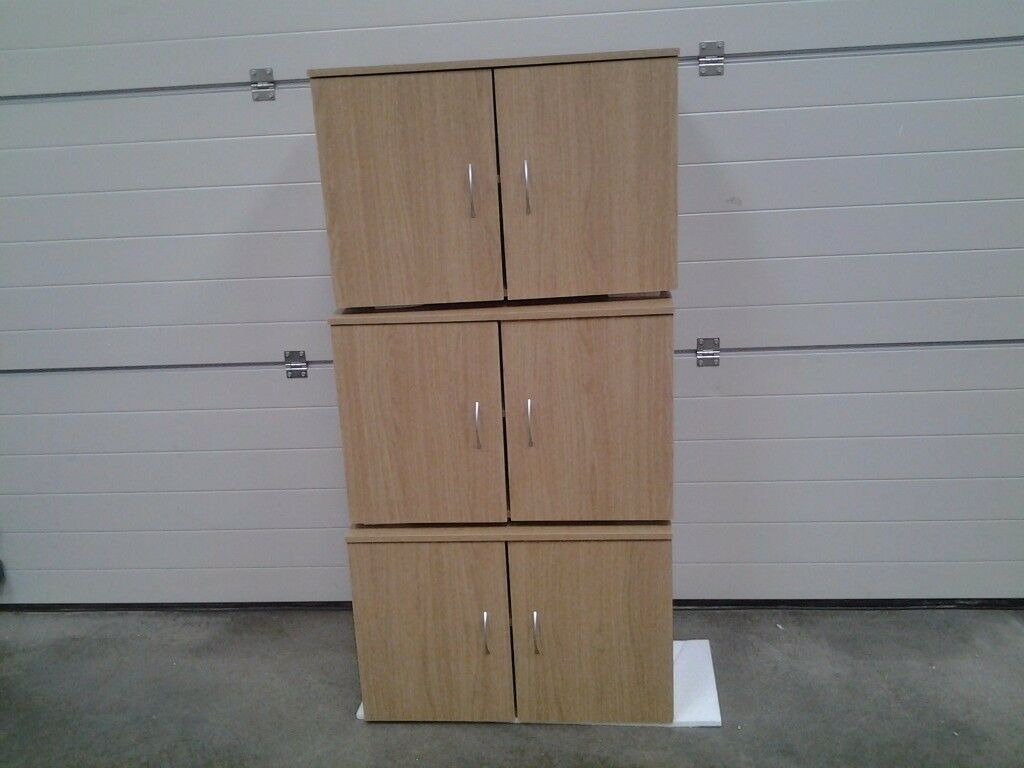 New Oak colour wall units / cupboards. Sold seperate. Bargain. Ideal utility / garage / playroom etc
