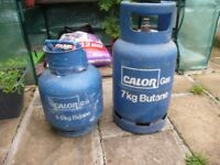 2 Calor gas bottles. 1 x4.5kg 1x7kg. small amount of gas in them