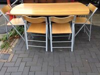 DROP LEAF TABLE AND FOUR FOLDING CHAIRS