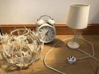 Lamp shade, beside lamp and alarm clock