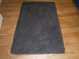 Chocolate brown shaggy pile rug in very good condition-been stored -hardly used