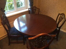 Traditional style dining table and four chairs.