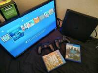 PlayStation 4 with TV and 7 games