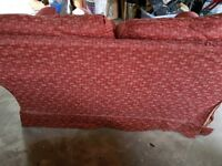 SOFA IN GOOD CONDITION. Coral colour ,has been recovered . Lovely fabric and very comfortable.