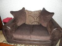 2x2 leather and fabric sofas hardly sat on