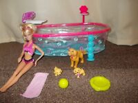 Barbie Puppy Swim School. Comes with one Barbie, swimming pool, 1 swimming dog, 2 puppies and more.