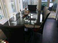 Glass dinning table and 4 high back leather chairs