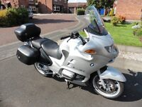 A very rare low mileage tourer with only 11,800 miles on the clock