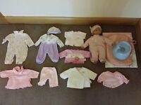 Doll and Seven Sets of Baby Born or Annabell Clothes