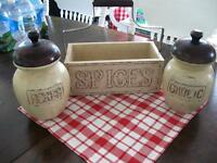Rustic wooden herb , garlic, and spice containers