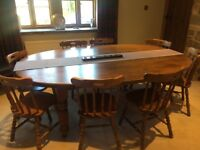 Large solid oak dining table and 8 chairs