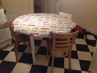 Table and 3 chairs with wipeable tablecloth