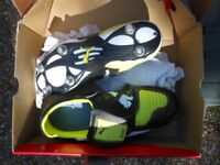 pair of puma rugby boots