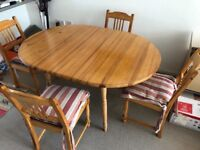 Solid wood dining table and 4 chairs with cushions for amazingly cheap £40