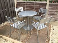 Silver metal round table and 4 chairs.