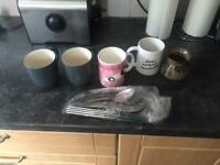 Few cups and mixed cutlery
