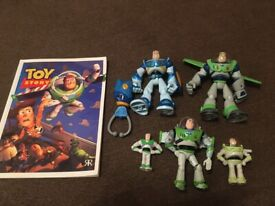 5 Buzz Lightyear figures and Toy Story book