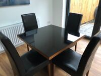 Black glass dinning room table with matching coffee table