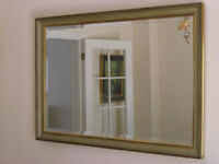 Mirror; Bevel edged glass in a gilt/taupe coloured frame