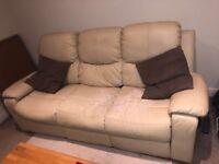 3 seater sofa faux cream leather.