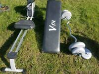 Rowing machine sit up bench and weights