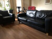 Black leather sofa with matching chair real leather very clean can deliver