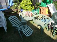 3x green garden chairs.