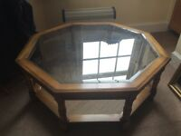 Octagonal glass topped large wooden coffee table
