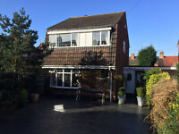 Large Three Bedroomed Detached Property set behind wrought iron gates.