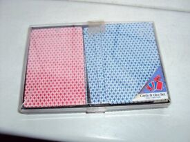 2 sets of playing cards in a plastic case